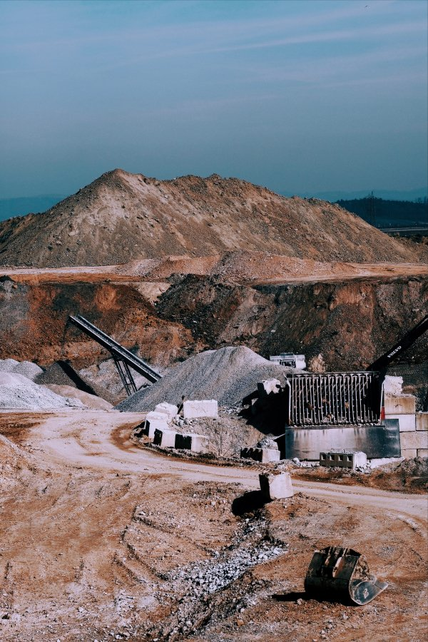 Agriculture & Mining - brown mountain under blue sky