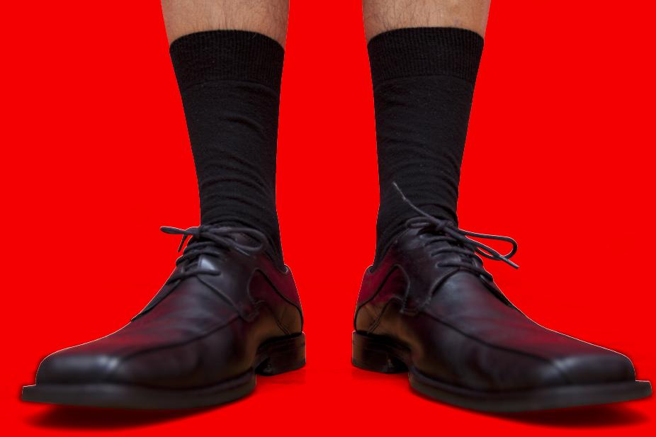 Man in socks & shoes